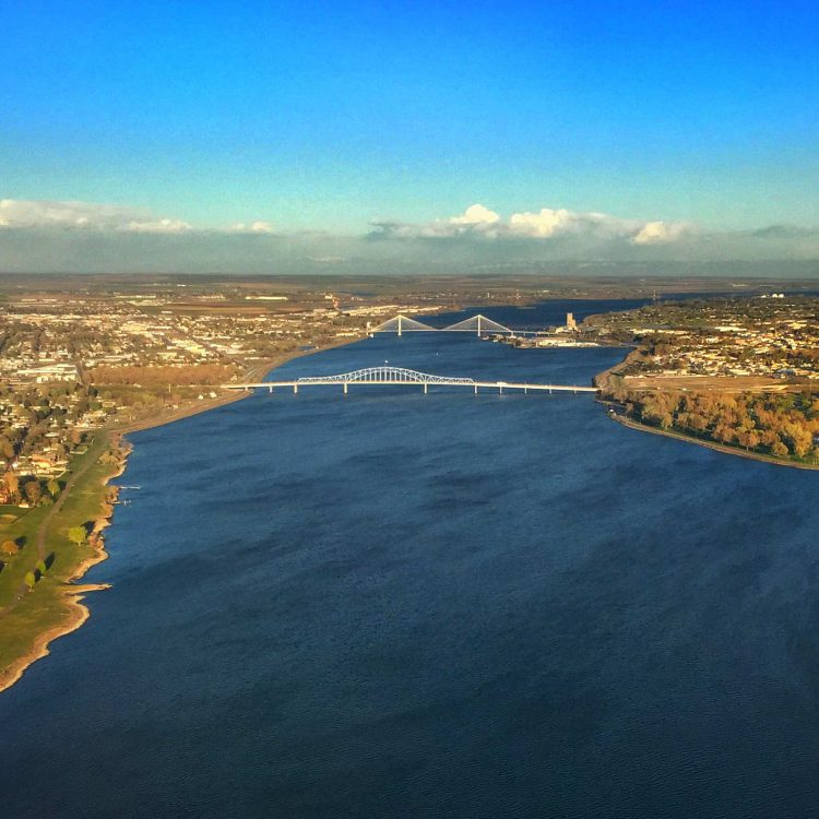 An aerial view of the Columbia River flowing through Tri-Cities of Washington